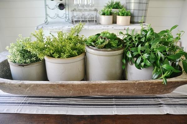 Stone crock greenery centerpiece