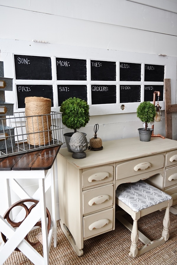 DIY door chalkboard calendar - a great chalkboard calendar made from an old door. Such a simple project that can help you keep your whole family organized. This would look great in an office, entryway, kitchen, command center, & more!