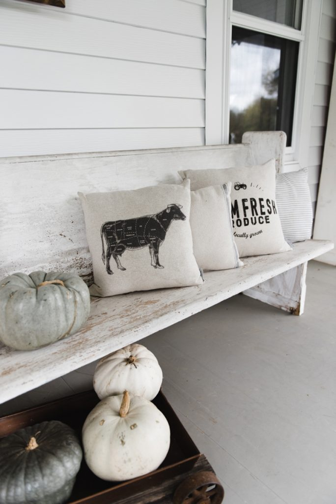 Farmhouse style porch - Church pew and farmhouse pillows on a porch... the perfect combo.