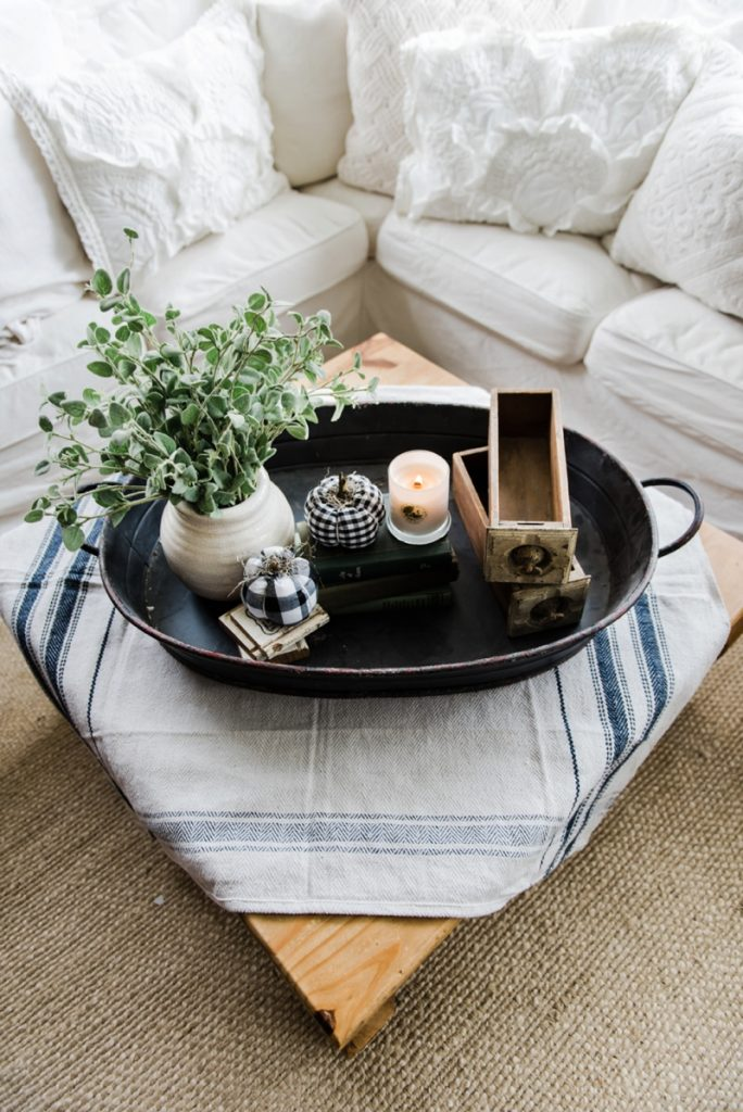 Farmhouse style coffee table in the sunroom - A lovely warm wood style coffee table style with a tablecloth on top to cozy it up. A great source for farmhouse & cottage style home decor!