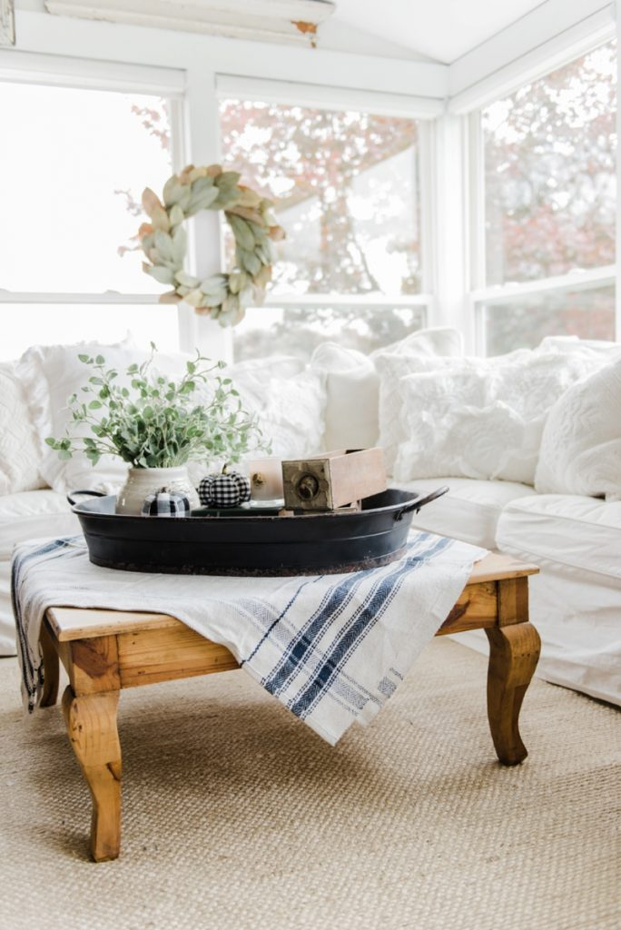 a farmhouse style coffee table in the sunroom. Black Bedroom Furniture Sets. Home Design Ideas