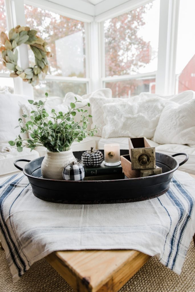 A farmhouse style coffee table in the sunroom Farm style coffee tables