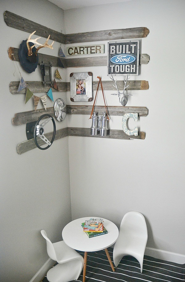 DIY corner gallery wall for a boys room using old barn wood, antlers, & other rustic details. The perfect focal point for any room & so easy to re-create!