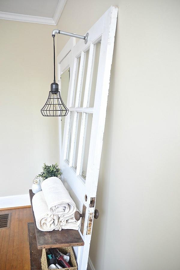 DIY door shelf with rustic pipe light fixture - lizmarieblog.com