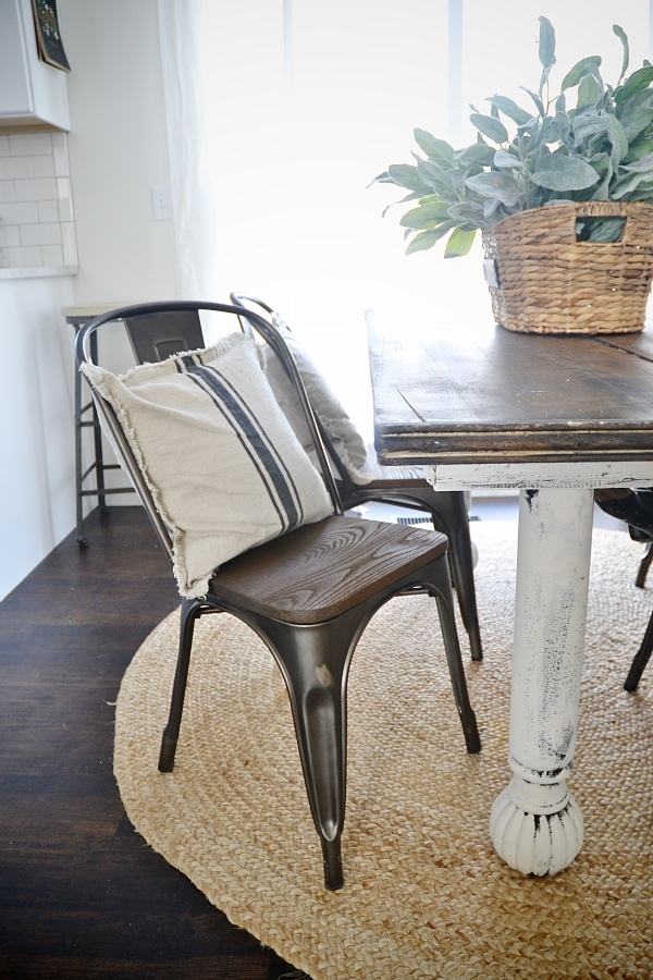 Rustic metal & wood dining chairs with a farmhouse table.