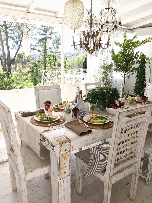 Rustic Chic brunch - brunch on the patio with a lovely farmhouse table, lots of plants, antique chandelier, & more! A must pin for any dinner party inspiration!  Great for baby showers, wedding showers, cocktail parties, bbq's, & more!