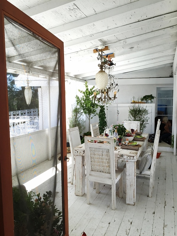 Rustic Chic brunch - brunch on the patio with a lovely farmhouse table, lots of plants, antique chandelier, & more! A must pin for any dinner party inspiration!
