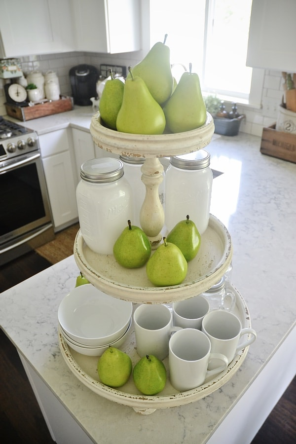Light & bright kitchen - shabby three tiered stand styled with everyday dishes & glasses.. perfect kitchen decor!