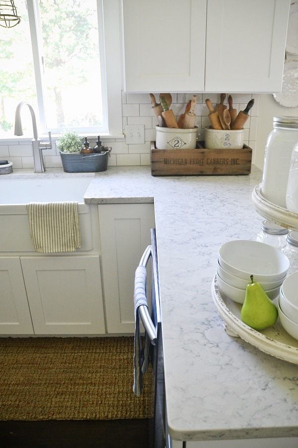 Quartz Countertop with White Kitchen Cabinets