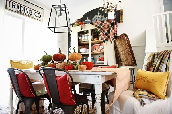rustic fall dining room - velvet pumpkin centerpiece, flannel, & tons of color.