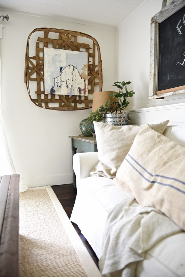 Cottage Style Living Room Makeover - Framing art from Deann Art in an antique tobacco basket.