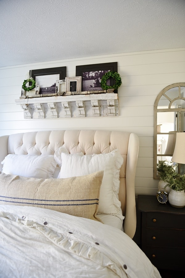 DIY shelf made out of salvaged corbels - Make a shelf out of salvaged items!  Lovely reclaimed wood shelf in a neutral cottage master bedroom inspiration.
