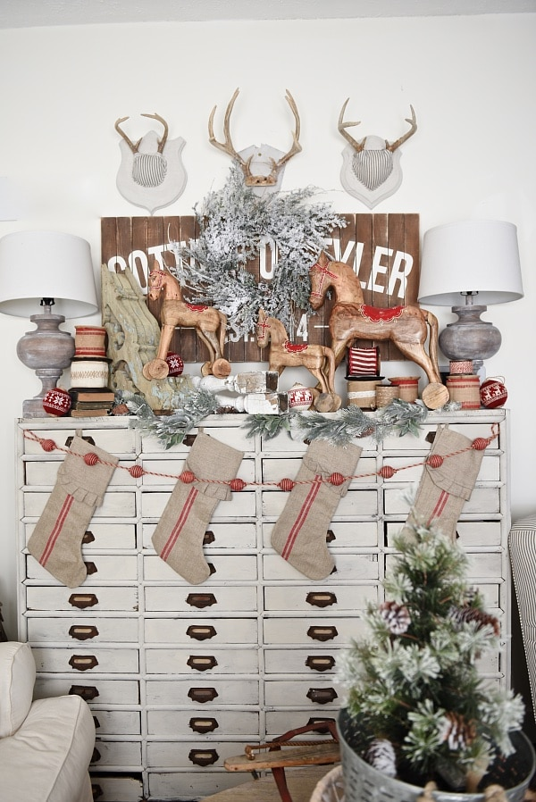 "Lovely Vintage Style Christmas decor on a ""faux mantel"" card catalog. Neutral farmhouse style christmas decor with pops of red."