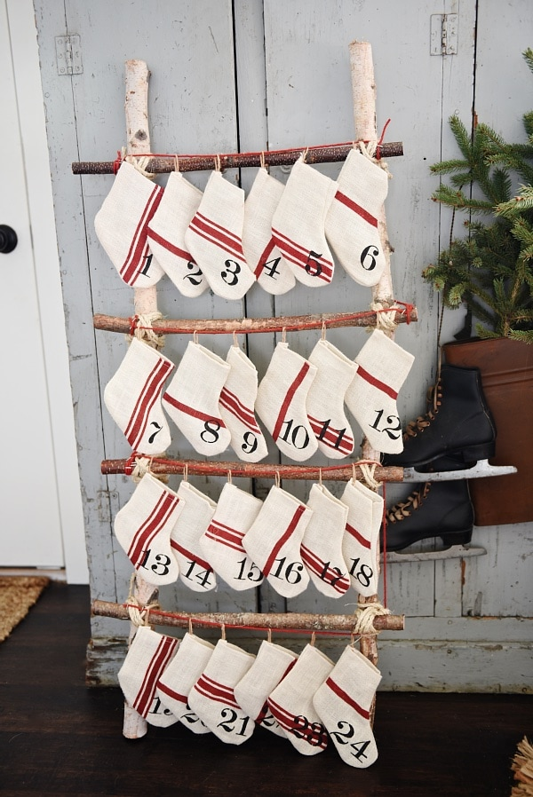 DIY ladder advent calendar - a super easy DIY project to count down to Christmas. Would be great to do with kids and fill it with a piece of candy or an ornament each day to hang on the tree.