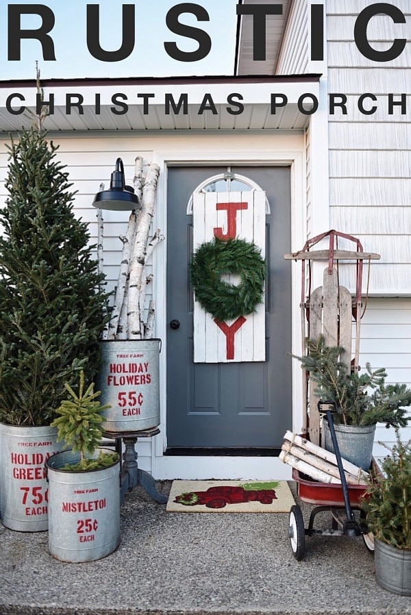 Rustic Christmas Porch - see how a small stoop gets decked out for the holidays. And see how to make this lovely Joy sign wreath too.
