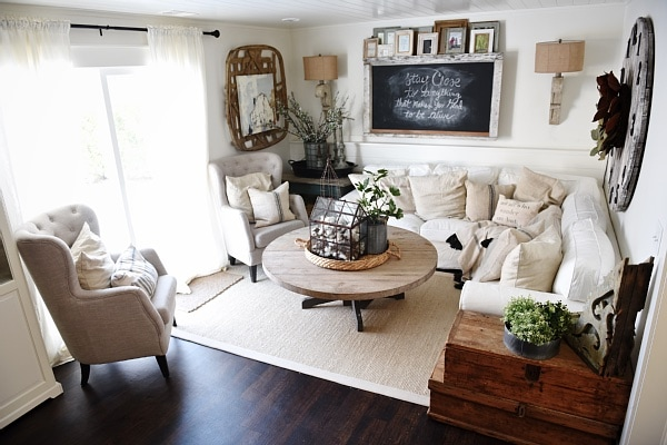 Cozy Neutral Farmhouse Style Living Room - With Ikea Ektorp Sectional. Cozy cottage style vibe makeover progress with source list of everything in the room - Great pin for neutral cozy home decor!