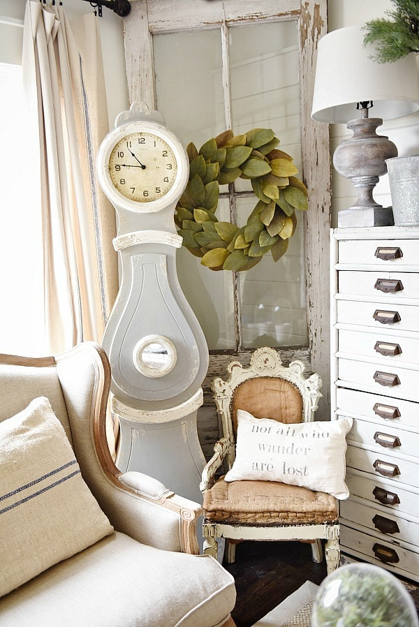 Cozy rustic cottage living room - Great pin for rustic farmhouse & cottage style decorating. A light and bright cozy living room with vintage touches like a settee, mora clock, card catalog, & so much more!