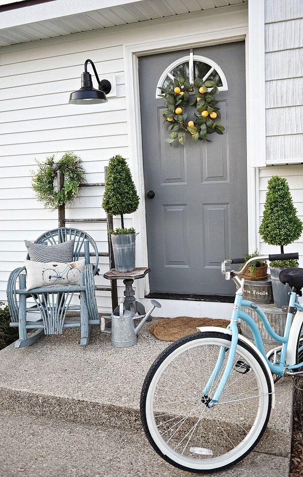 Lovely simple spring & summer porch. A great farmhouse style & cottage style front porch decor using found & new items. Pops of faux greenery so it's low maintenance too!