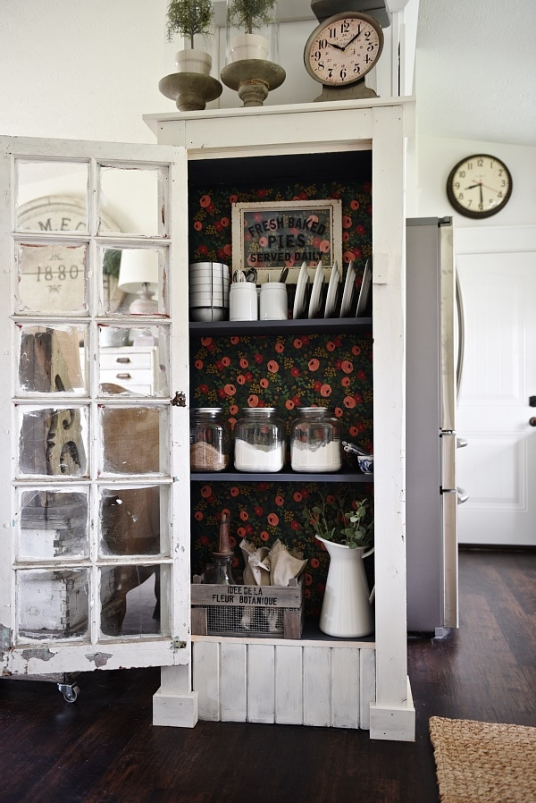 DIY Rustic window cabinet - so easy to build! This cabinet would be great in any room of the house for pretty storage. A great idea to add wrapping paper to the back of the cabinet for a pop of color.