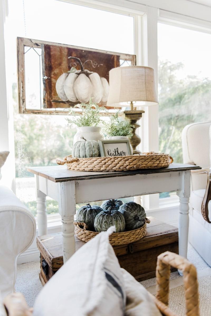 Neutral fall decor - A cozy farmhouse fall sunroom. A must pin for cozy fall decor inspiration!