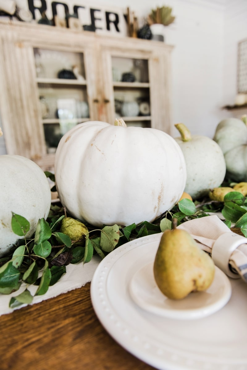 Rustic heirloom pumpkin and pear farmhouse table centerpiece
