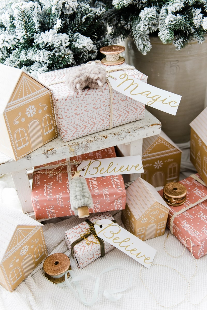 Farmhouse Gingerbread House Gift Wrap - Check out this rose gold gingerbread house gift wrap - a great pin for farmhouse & cottage style Christmas decor inspiration.