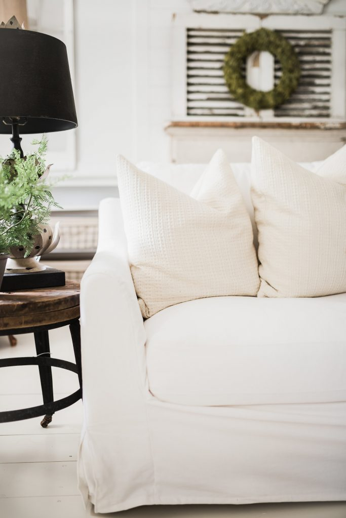 Bemz White Farmhouse Slipcover next to a rustic coffee table