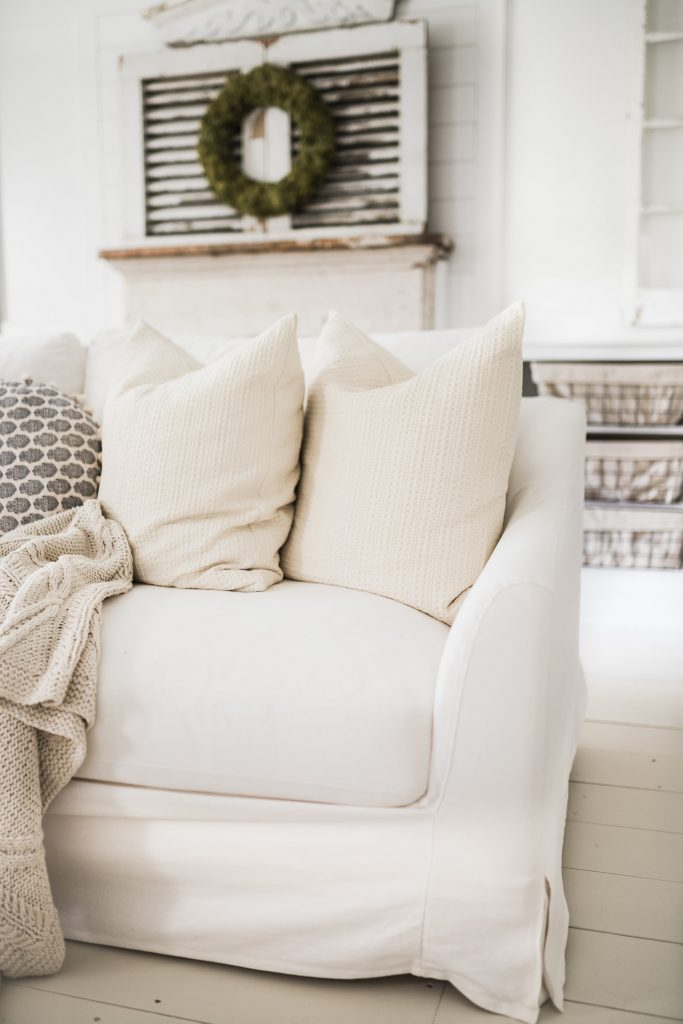 Simple Linen Slipcover from Bemz in front of a farmhouse fireplace