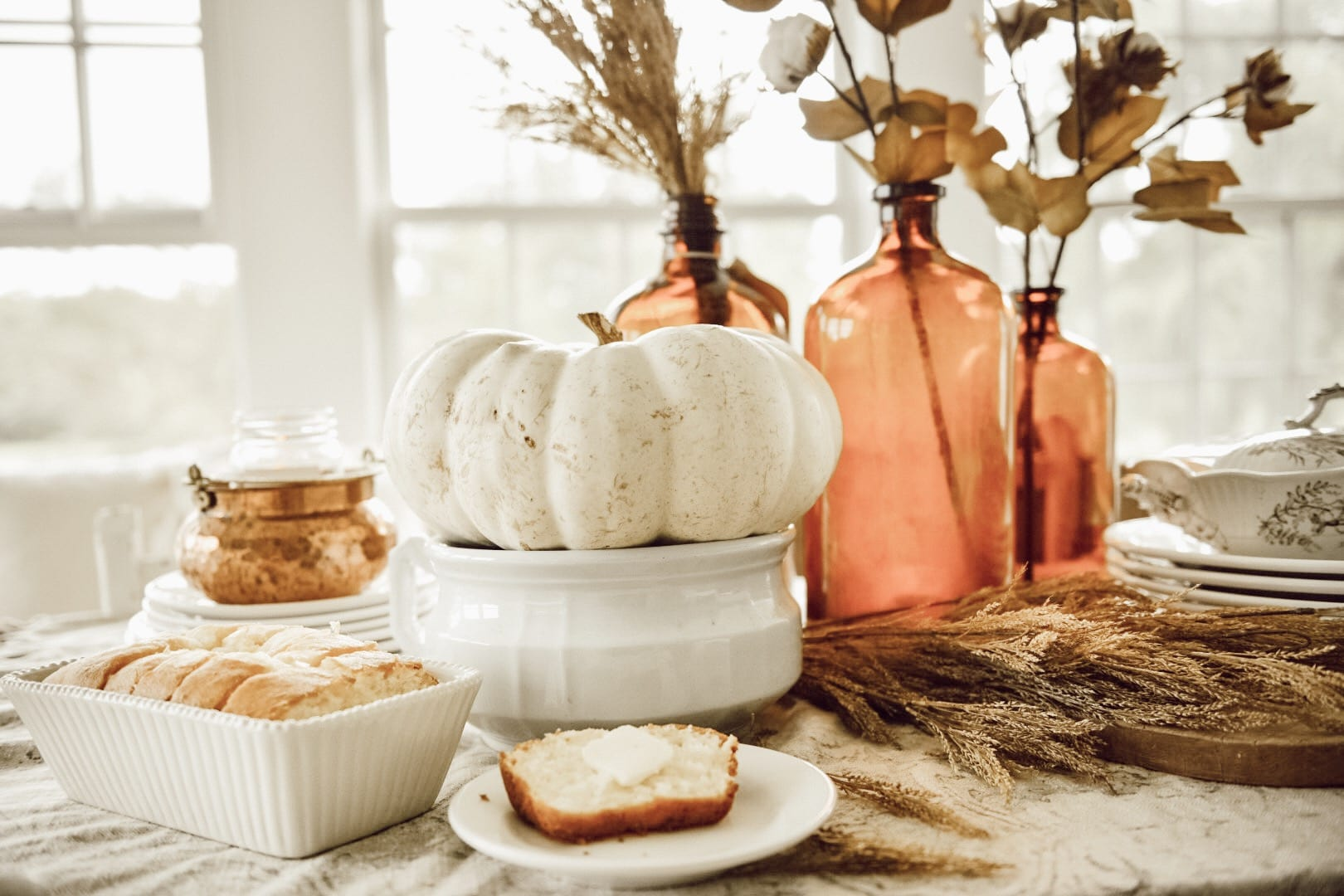 A simple Amber Bottle Fall Tablescape