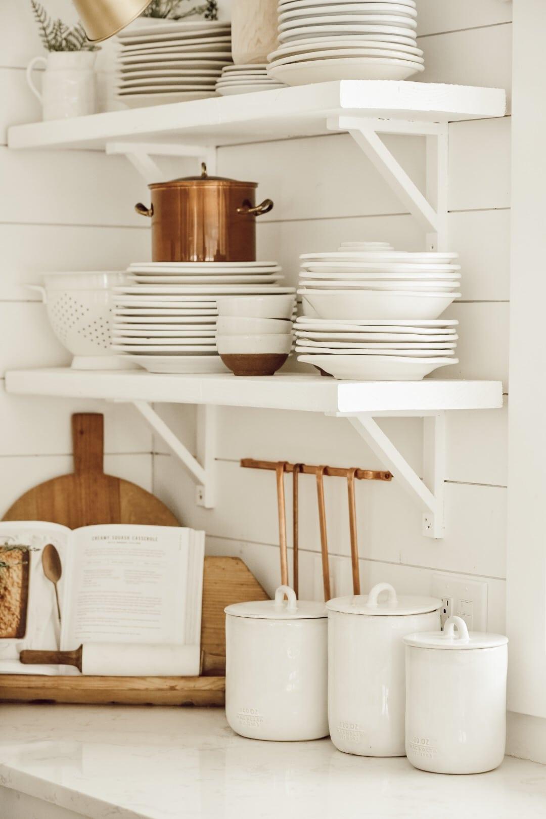 Plates on open kitchen shelves