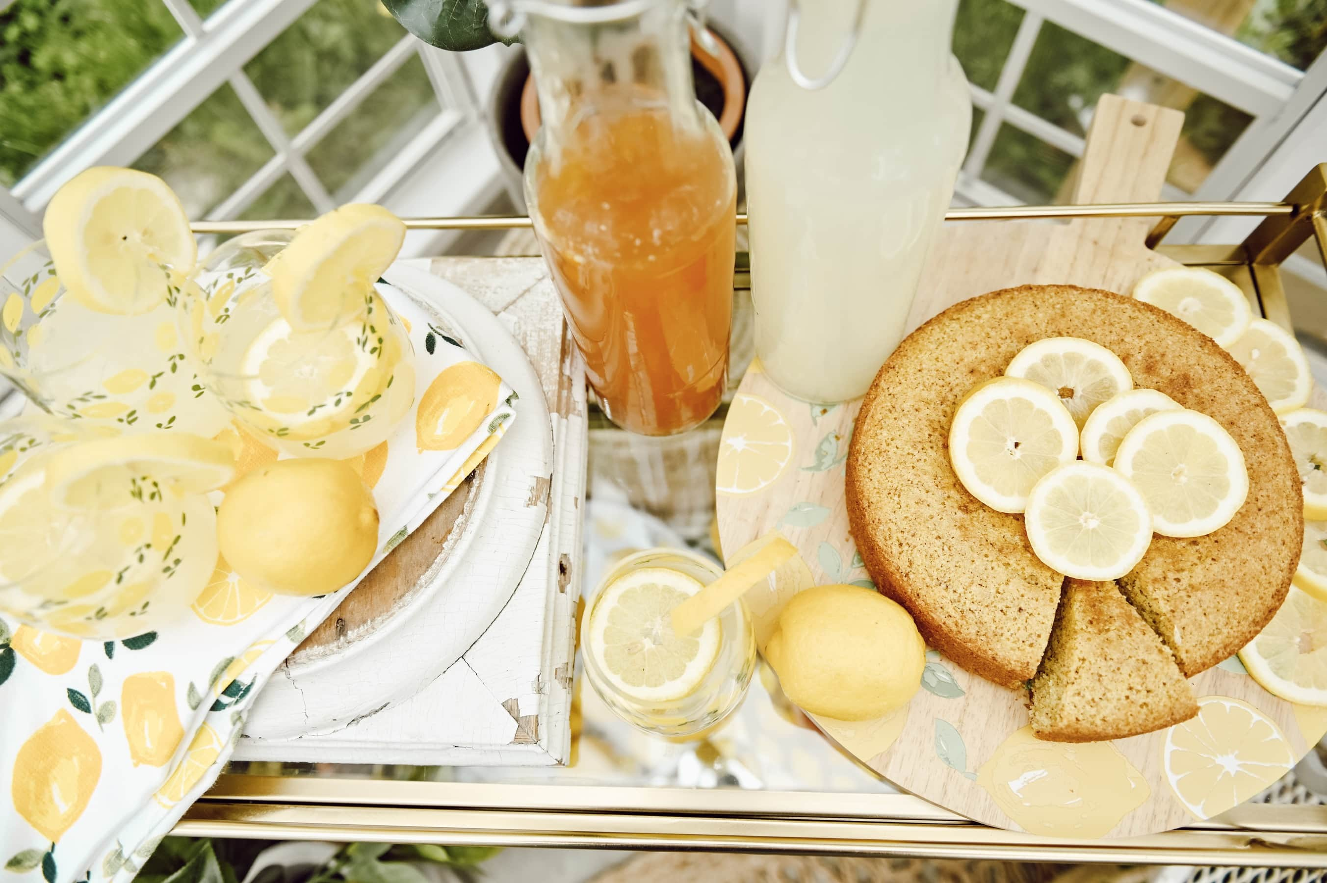 Lemon themed party with drinks, lemon cake, and lemons