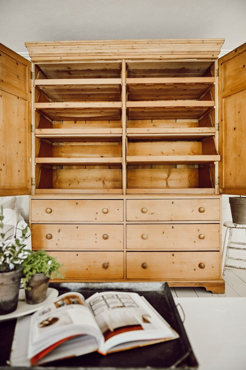 Doors open of vintage pine cabinet