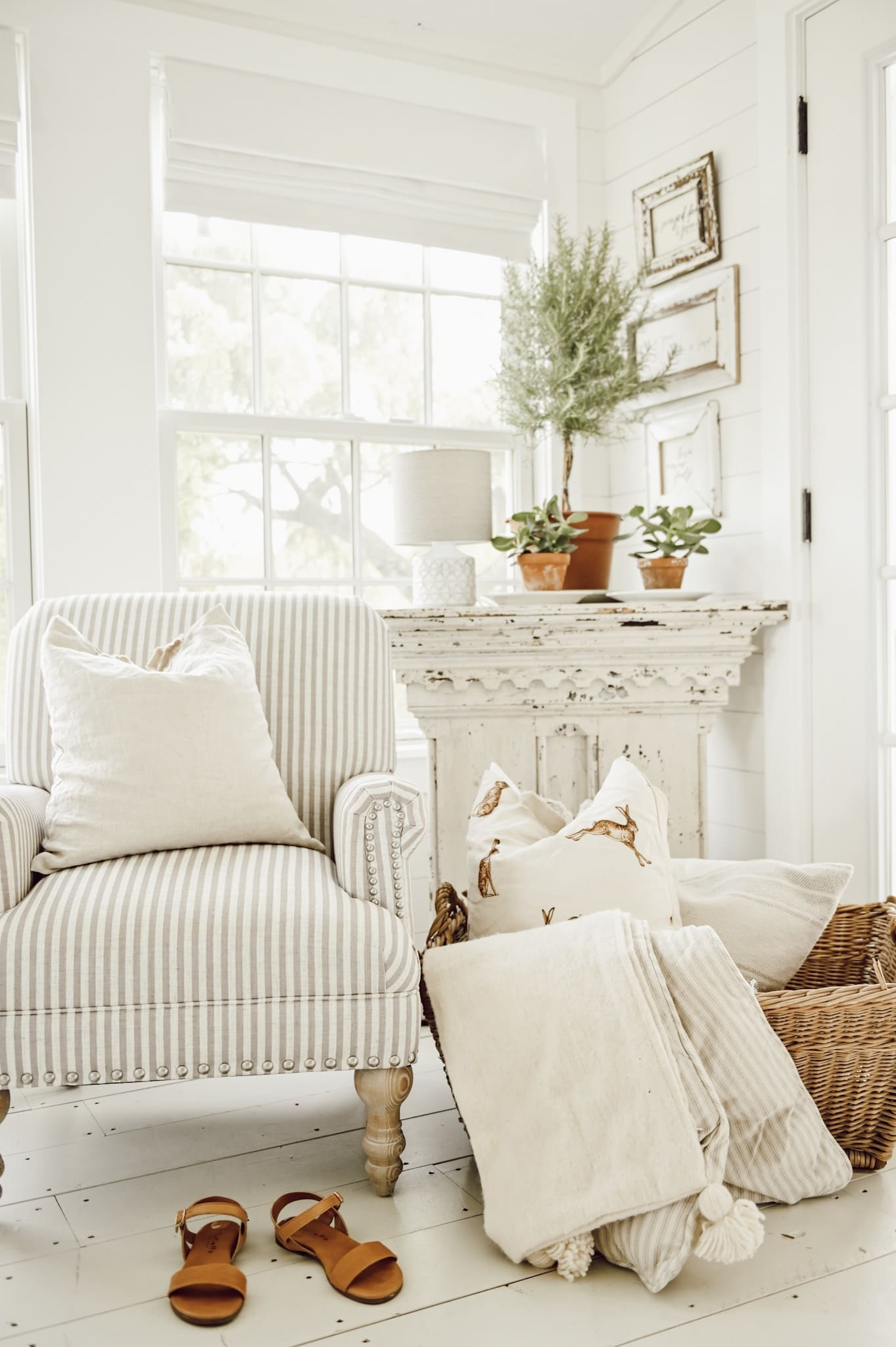 If you have some white space, fill it with a basket with cozy throws and pillows in it for your guests.