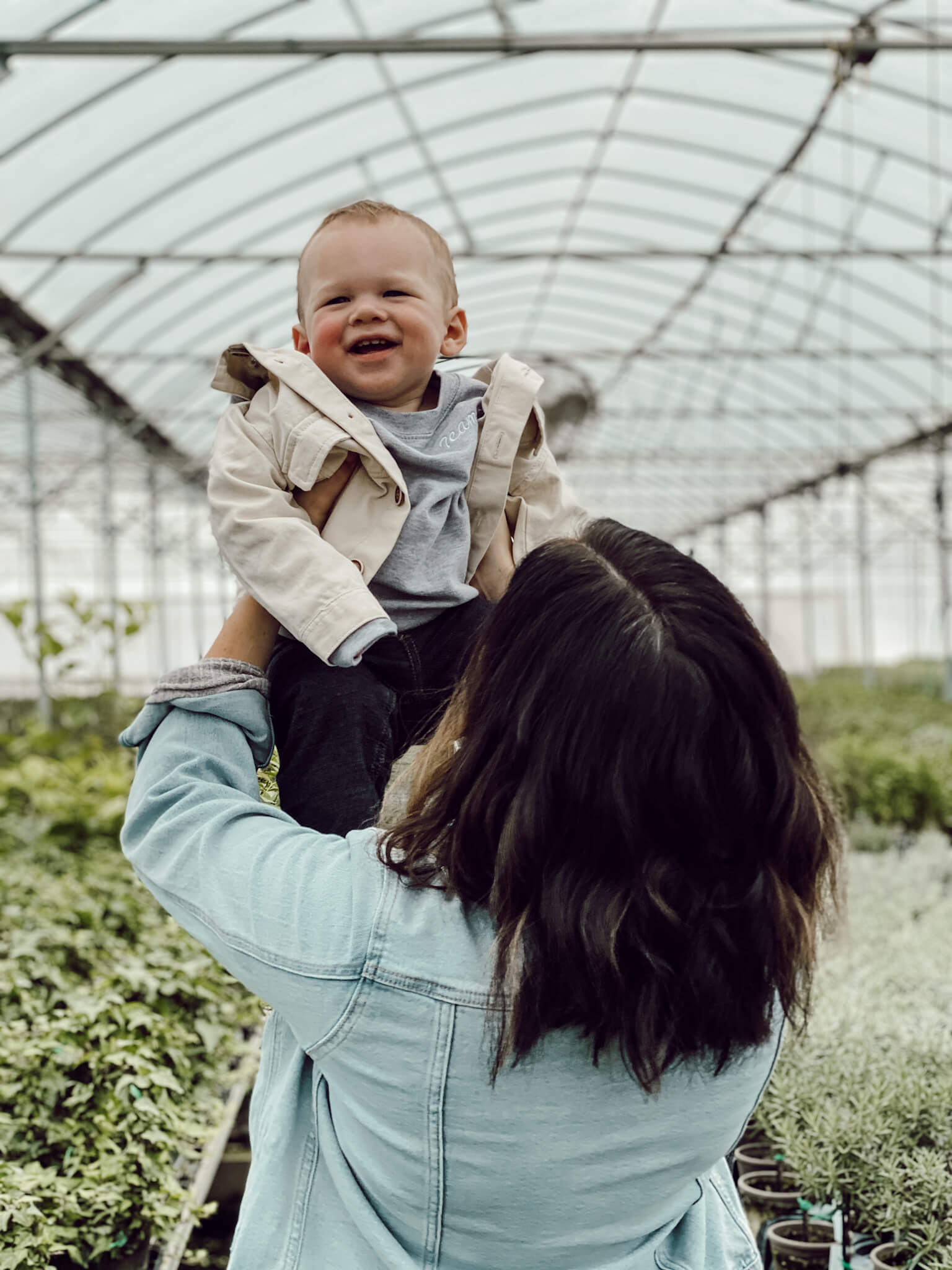 Liz Marie and Cope in a greenhouse