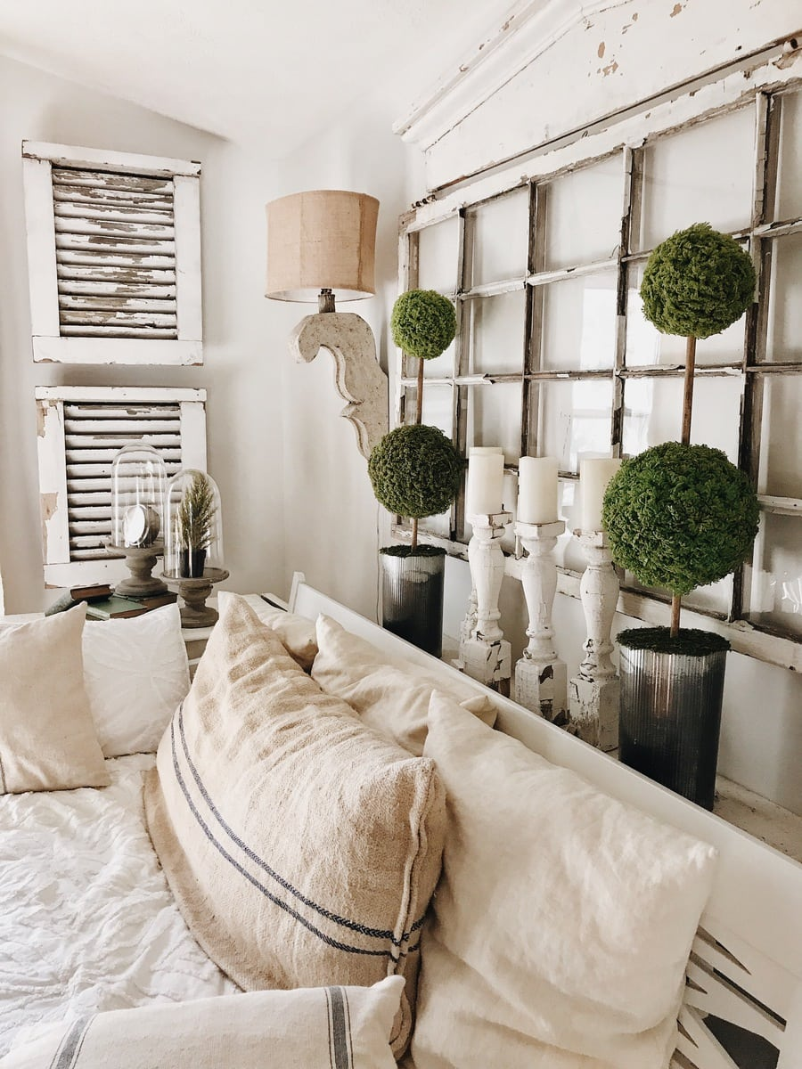 Example of DIY Moss Topiaries behind a sofa