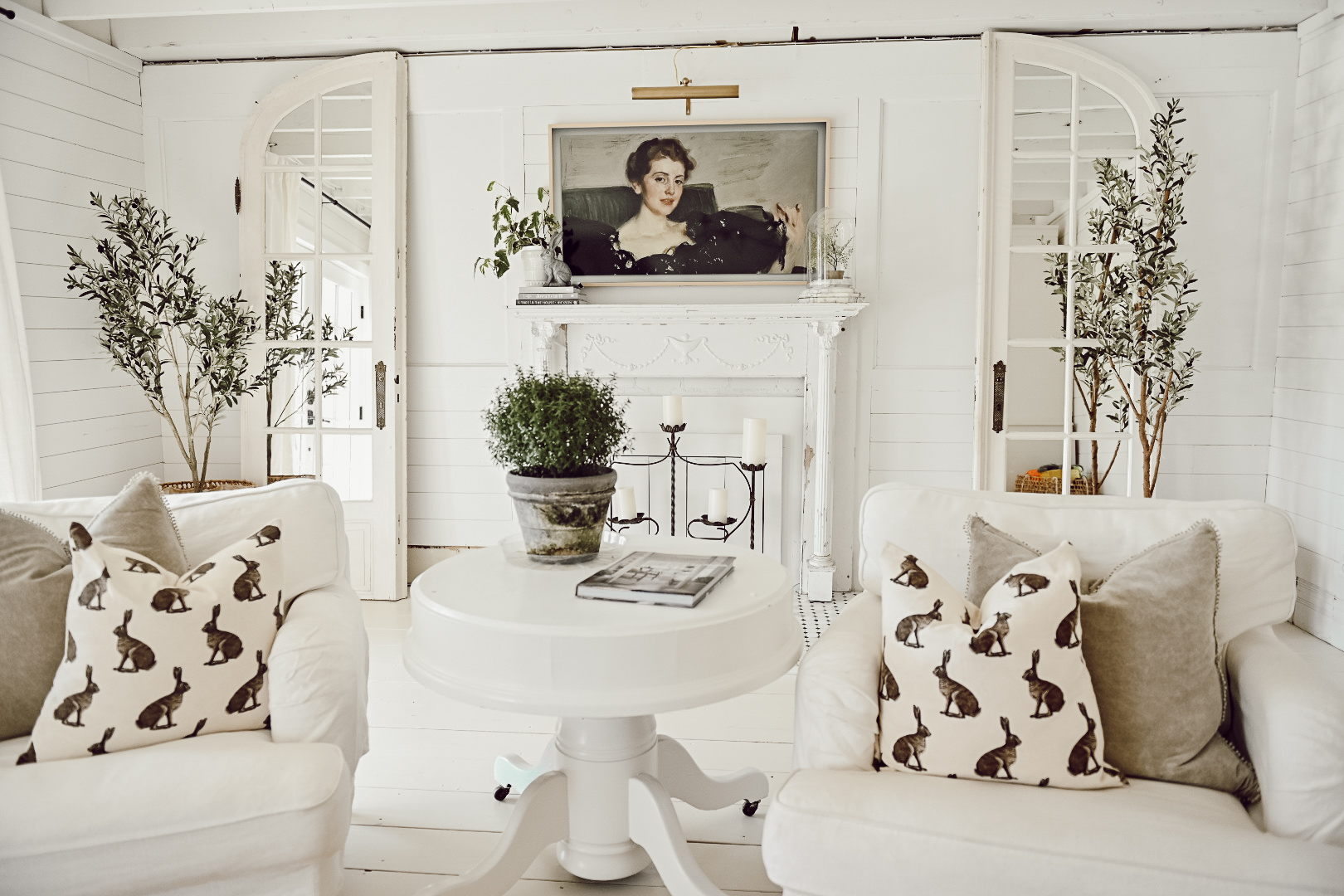 White Farmhouse Living room with Samsung Fire TV mounted about a white fireplace mantel