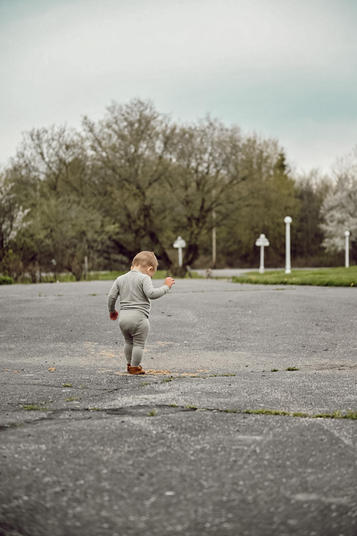 Wide Shot of Little boy walking
